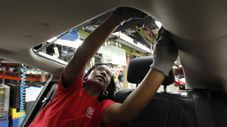 In this July 27, 2011 photo, assembly worker Julaynne Trusel works on a Chevrolet Volt at the General Motors Hamtramck Assembly plant in Hamtramck, Mich. A private trade group says manufacturing activity barely grew in July, falling to the weakest level since just after the recession ended. (AP Photo/Paul Sancya)