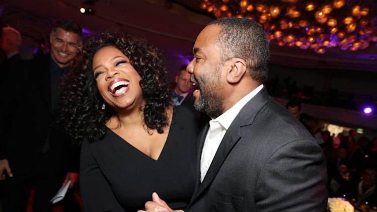 IMAGE DISTRIBUTED FOR THE HOLLYWOOD REPORTER - Oprah Winfrey, left, and Lee Daniels attend THR's celebration of power 100 women in entertainment breakfast on Wednesday, Dec. 11, 2013 in Beverly Hills, Calif. (Photo by Eric Charbonneau/Invision for The Hollywood Reporter/AP Images)