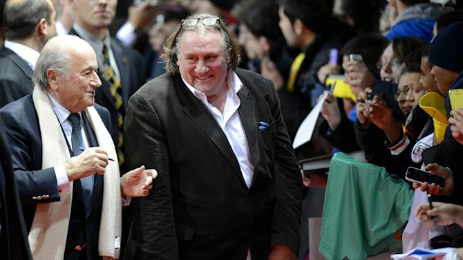 "FIFA President Joseph ""Sepp"" Blatter, left, and French-Russian actor Gerard Depardieu, right, arrive for the FIFA Ballon d'Or Gala 2013 held at the Kongresshaus in Zurich, Switzerland, on Monday, Jan. 7, 2013. French actor Gerard Depardieu has received a Russian passport after he  sought Russian citizenship as part of his battle against a proposed super tax on millionaires in France.  (AP Photo/Keystone/Walter Bieri)"