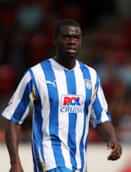 Magnus Okuonghae has signed a new deal at Colchester just weeks after he looked destined to leave the club