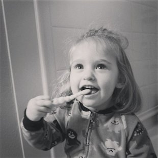 Brushing my toddler's teeth with sugar.