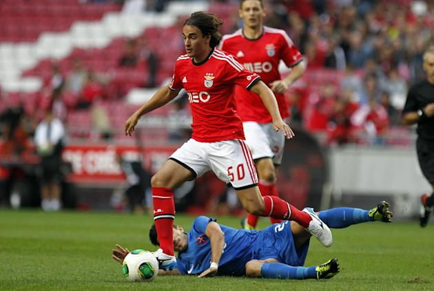 Benfica's Lazar Markovic, foreground, from Serbia, battles for the ball with Belenenses' Joao Pedro Cunha, on the ground, during their Portuguese league soccer match at Benfica's Luz stadium, in Lisbo