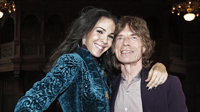 FILE - This Feb. 16, 2012, file photo, shows singer Mick Jagger, right, with designer L'Wren Scott after her Fall 2012 collection was modeled during Fashion Week, in New York. Scott has left her entire estate to longtime boyfriend and Rolling Stones frontman Jagger. Scott committed suicide on March 17, in New York. (AP Photo/Richard Drew, File)