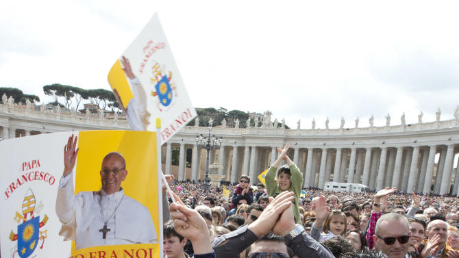 Faithful wave flags as Pope Francis delivers his Regina Coeli prayer from his studio window overlooking  St. Peter's Square at the Vatican, Monday, April 1, 2013. (AP Photo/Alessandra Tarantino)