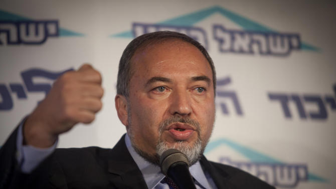 Israel's Foreign Minister Avigdor Lieberman speaks to the media during an event in Tel Aviv, Israel, Thursday, Dec. 13, 2012.  Israel's powerful foreign minister resisted calls to resign after he was charged Thursday with breach of trust for actions that allegedly compromised a criminal investigation into his business dealings, throwing the country's election campaign into disarray just weeks before the vote.  (AP Photo/Dan Balilty)