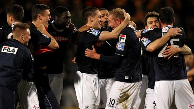 Luton Town's players celebrate their victory over Norwich City