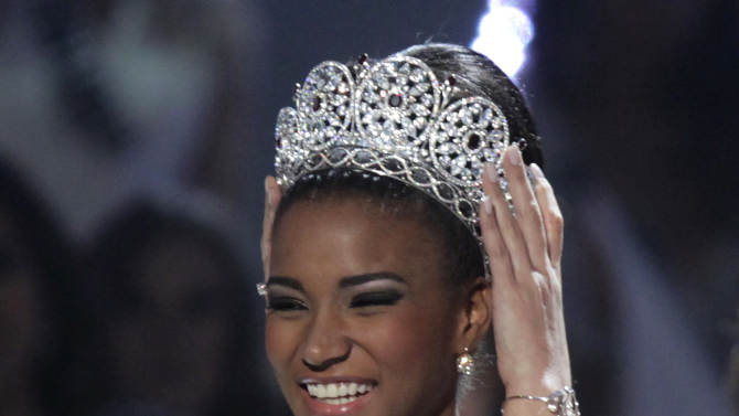 Miss Angola Leila Lopes is crowned Miss Universe 2011 by Miss Universe 2010 Ximena Navarrete, of Mexico, in Sao Paulo, Brazil, Monday Sept. 12, 2011. (AP Photo/Andre Penner)