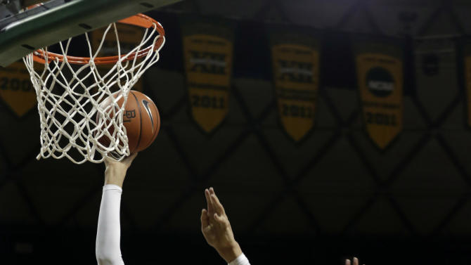 Baylor's Brittney Griner (42) shoots against Oklahoma's Nicole Griffin (4) during the first half of an NCAA college basketball game Saturday, Jan. 26, 2013, in Waco Texas. (AP Photo/LM Otero)