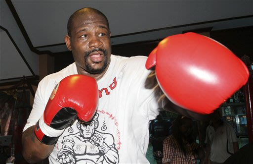 Former heavyweight boxing champion Riddick Bowe of the United States throws a punch during a sparring in Bangkok, Thailand Saturday, May 18, 2013. Bowe, 45, is returning to the ring by fighting agains