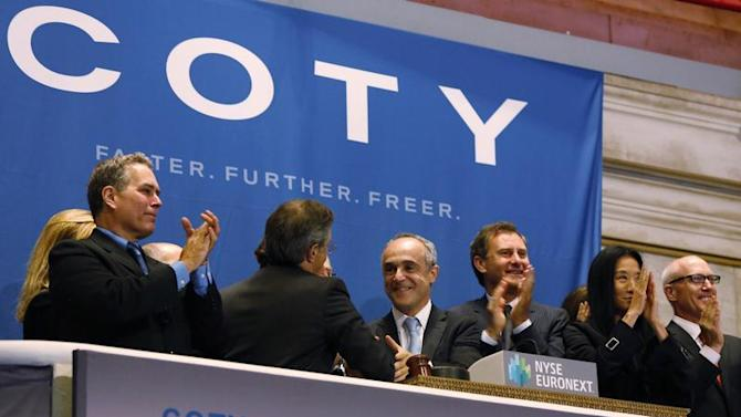 Michele Scannavini,CEO of Coty Inc.,ing the opening bell at the New York Stock Exchange to celebrate the company's IPO