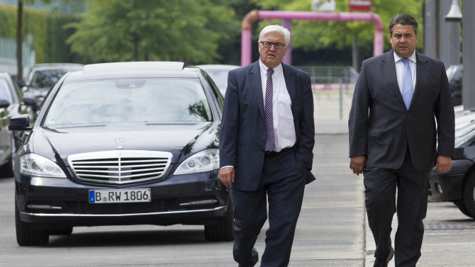 Opposition Social Democratic Party chairman Sigmar Gabriel, right and THE party's parliament floor leader Frank-Walter Steinmeier, left, leave the chancellery after a meeting with Chancellor Angela Merkel in Berlin, Germany, Wednesday, June 13, 2012. German Chancellor Angela Merkel had holding talks with the country's opposition leaders to forge a compromise on proposals for a European growth initiative. (AP Photo/Markus Schreiber)