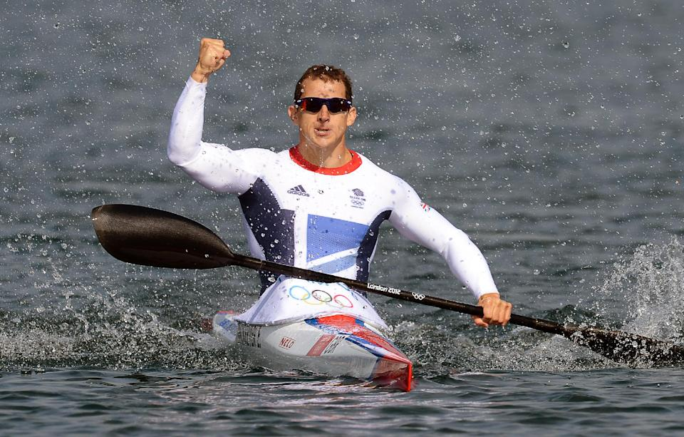 Britain's Ed Mckeever celebrates after winning the gold medal in the kayak single 200-meter men's final at the 2012 Summer Olympics, Saturday, Aug. 11, 2012,  in Eton Dorney, near Windsor, England. (AP Photo/Francisco Leong, Pool)