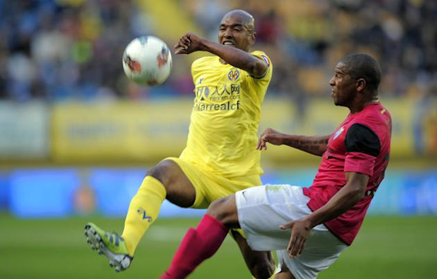 Malaga's Venezuelan Forward Salomon Rondon   (R) Vies AFP/Getty Images