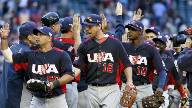 United States' Shane Victorino, left, Ben Zobrist (12) and Adam Jones (10) celebrate a win over Canada after the ninth inning in a World Baseball Classic baseball game on Sunday, March 10, 2013, in Phoenix.  The United States defeated Canada 9-4. (AP Photo/Ross D. Franklin)