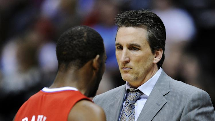 Los Angeles Clippers head coach Vinny Del Negro, right, looks at Chris Paul during the fourth quarter of an NBA basketball game against the Denver Nuggets, Tuesday, Jan. 1, 2013, in Denver. The Nuggets won 92-78 to break the Clippers 17-game winning streak. (AP Photo/Jack Dempsey)