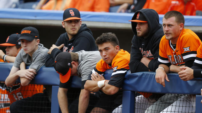 Oklahoma players watch from the dugout in the fourth inning of the championship game against Texas in the Big 12 conference NCAA college baseball tournament championship game, Sunday, May 24, 2015, in Tulsa, Okla. Texas won 6-3. (AP Photo/Sue Ogrocki)