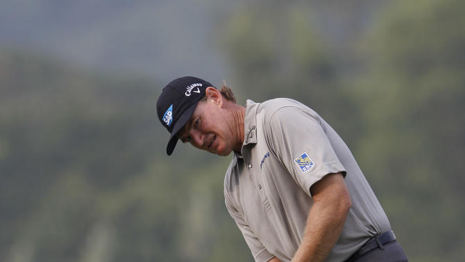 Ernie Els from South Africa makes a putt on the 18th green during the third round of the HSBC Champions golf tournament in Dongguan, southern China's Guangdong province, Saturday, Nov. 3, 2012. (AP Photo/Kin Cheung)