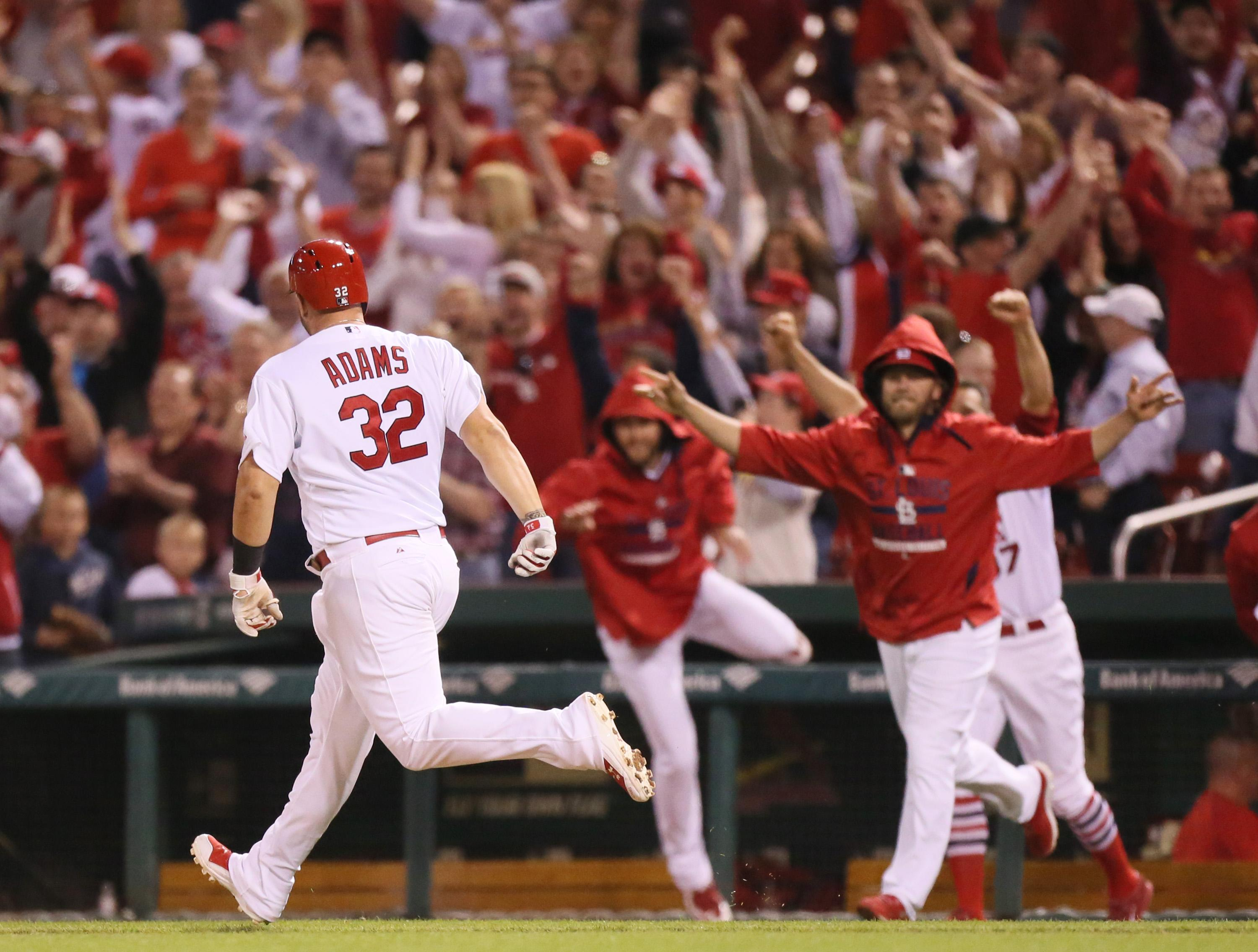 Adams gives Cardinals 2-1 win over Pirates in 10 innings