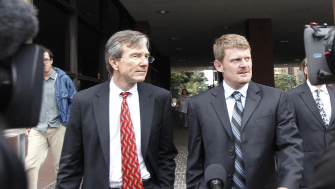 """FILE - This Aug. 24, 2012 file photo shows Floyd Landis, right, and his attorney, Leo Cunningham,  leaving federal court in San Diego. The International Cycling Union says it won a Swiss court ruling prohibiting Landis from repeating claims that its leaders corruptly protected Lance Armstrong from a doping case. The governing body says the defamation judgment """"upholds and protects the integrity of the UCI and its presidents."""" (AP Photo/Lenny Ignelzi, File)"""