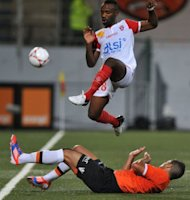 Nancy&#39;s midfielder Lossemy Karaboue jumps to avoid a tackle during their French L1 football match against Lorient at the Moustoir Stadium in Lorient, western France. Lorient won 3-0