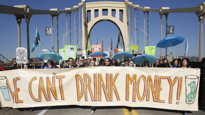 FILE- In this Nov. 3, 2010 file photo, marchers concerned with water pollution protest against hydraulic fracturing and gas well drilling as they cross the Rachel Carson Bridge on their way through town to the Developing Unconventional Gas (DUG) East convention and exhibition being held in Pittsburgh. Pennsylvania officials say there have been 370 complaints so far in 2013 alleging that oil or natural gas drilling polluted or diminished the flow of water to private water wells. But The Associated Press found that a lack of detail in the data make it almost impossible to judge whether the drilling boom is harming more individuals than in the past, or less. (AP Photo/Keith Srakocic, File)