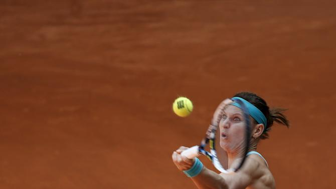 Safarova of the Czech Republic returns the ball to Pironkova of Bulgaria during their match at the Madrid Open tennis tournament in Madrid