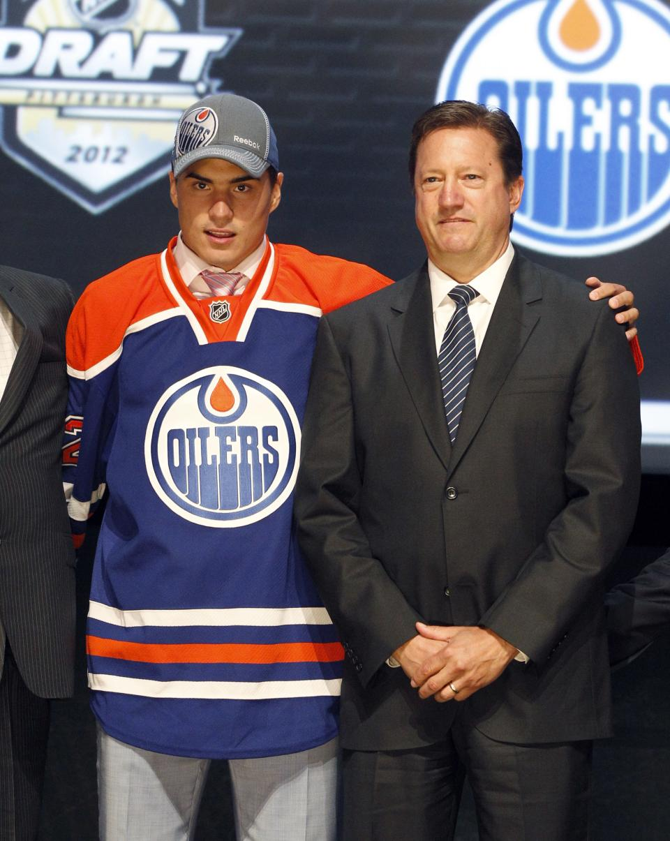 Nail Yakupov, left, a winger from Russia who was chosen first overall by the Edmonton Oilers in the first round of the NHL hockey draft, stands with Oilers general manager Steve Tambellini on Friday, June 22, 2012, in Pittsburgh. (AP Photo/Keith Srakocic)
