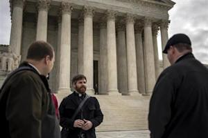 Christian clergy members gather outside the U.S. Supreme Court as it hears arguments in the case of Town of Greece, NY v. Galloway, in Washington