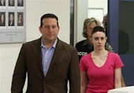 Casey Anthony and her lawyer Jose Baez (L) leave the Orange County Jail in Orlando, Florida July 17, 2011.REUTERS/Red Huber/Pool