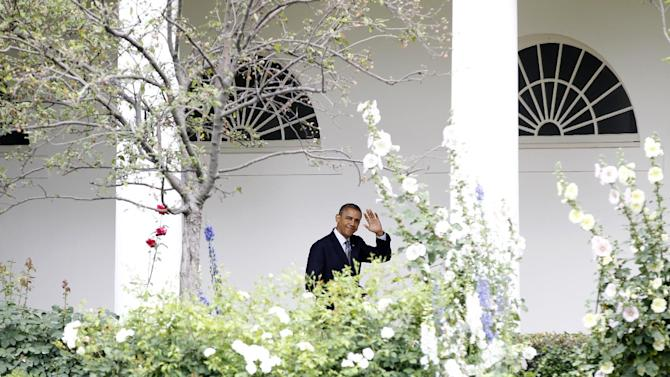 President Barack Obama waves as he walks through the West Wing Colonnade of the White House in Washington, Thursday, June 14, 2012,  before boarding Marine One, Thursday, June 14, 2012, on the South Lawn. (AP Photo/Haraz N. Ghanbari)