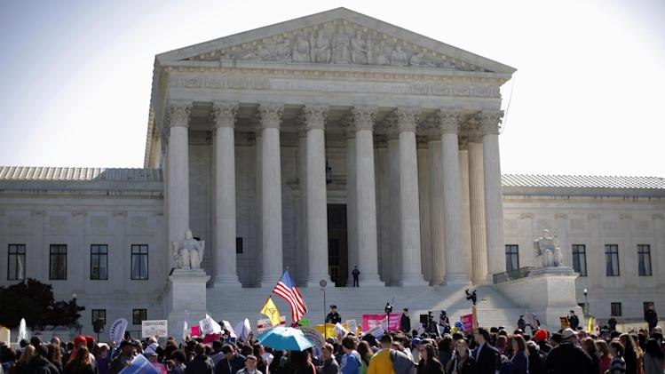 Supporters and opponents of health care reform rally in front of the Supreme Court in Washington, Tuesday, March 27, 2012, as the court continued arguments on the health care law signed by President Barack Obama. (AP Photo/Charles Dharapak)