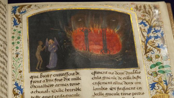 "In this photo taken Tuesday, May 29, 2012, A detail of ""The Beast Acheron,"" a medieval miniature made of tempera colors, gold leaf, gold paint, and ink on parchment, is displayed at the ""Heaven, Hell and Dying Well: Images of Death in the Middle Ages"" exhibit at The Getty Museum in Los Angeles. In this miniature ""The Beast Acheron,"" attributed to french artist, Simon Marmion, Valenciennes, 1475, Tondal's wandering soul observes the punishments meted out in Hell to the greedy. The illuminator has envisioned the entrance to Hell as the mouth of the beast Acheron, whose name derives from Greek mythology, referring to the river in Hades or Hell. (AP Photo/Damian Dovarganes)"