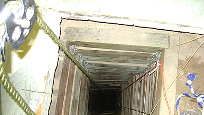 In this undated photo provided by the United States Drug Enforcement Administration, shows the tunnel shaft entrance on the U.S. side of a 240-yard, complete and fully operational drug smuggling tunnel that ran from a small business in Arizona to an ice plant on the Mexico side of the border, Thursday, July 12, 2012, in San Luis, Ariz.(AP Photo/Drug Enforcement Administration)