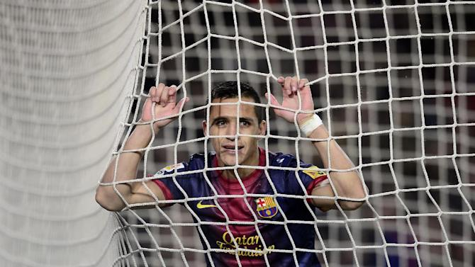 FC Barcelona's Alexis Sanchez, from Chile, reacts against Rayo Vallecano during a Spanish La Liga soccer match at the Camp Nou stadium in Barcelona, Spain, Sunday, March 17, 2013. (AP Photo/Manu Fernandez)