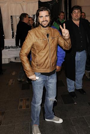 Latin singer Juanes arrives to see Bruce Springsteen and the E Street Band perform at the Apollo Theater on Friday, March 9, 2012 in New York. The concert was hosted by SiriusXM in celebration of 10 years of satellite radio. (AP Photo/Evan Agostini)
