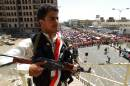 A Yemeni supporter of the Shiite Huthi rebels stands guard during a celebratory rally after the anti-government movement seized key state installations, on September 26, 2014 in the capital Sanaa