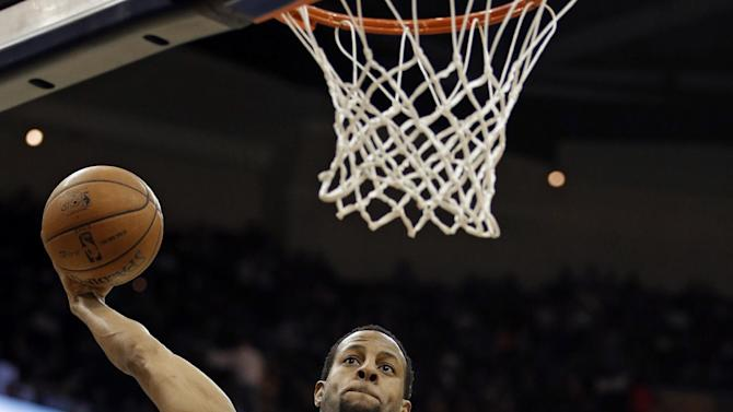 Denver Nuggets' Andre Iguodala soars in for a dunk against the Cleveland Cavaliers in the first quarter of an NBA basketball game Saturday, Feb. 9, 2013, in Cleveland. (AP Photo/Mark Duncan)