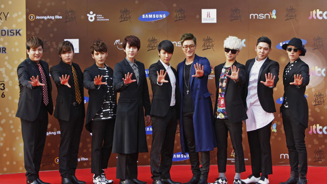 South Korean boy group Super Junior poses for photographers as they arrive on the red carpet ahead of the 27th Golden Disk Awards in Sepang, Malaysia, Tuesday, Jan. 15, 2013. (AP Photo/Lai Seng Sin)