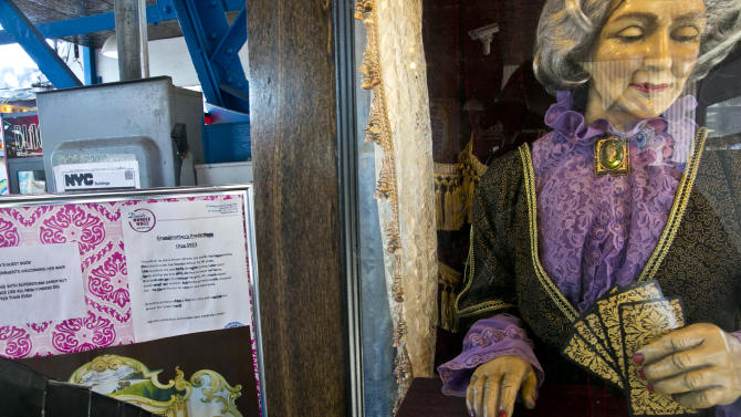 """This June 12, 2013 photo shows the 90-year-old fortune telling machine """"Grandma's Predictions,"""" which was restored after damage in superstorm Sandy at the amusement park in the Coney Island neighborhood in the Brooklyn borough of New York. (AP Photo/Bebeto Matthews)"""