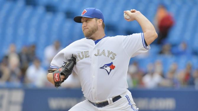 Toronto Blue Jays starting pitcher Mark Buehrle pitches to the Atlanta Braves during first inning interleague baseball action in Toronto on Monday, May 27, 2013. (AP Photo/The Canadian Press, Nathan Denette)