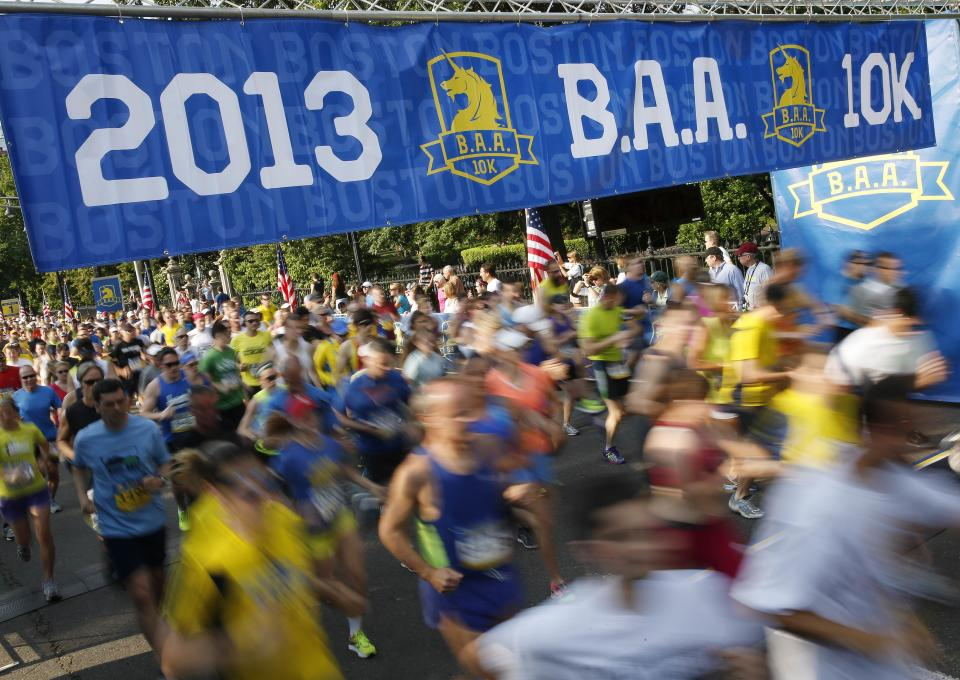 Runners cross the start line in the Boston Athletic Association 10k in Boston, Sunday, June 23, 2013. More than 6,400 runners took part in Boston's first major race since the April marathon bombings that killed three people and injured hundreds of others. (AP Photo/Michael Dwyer)