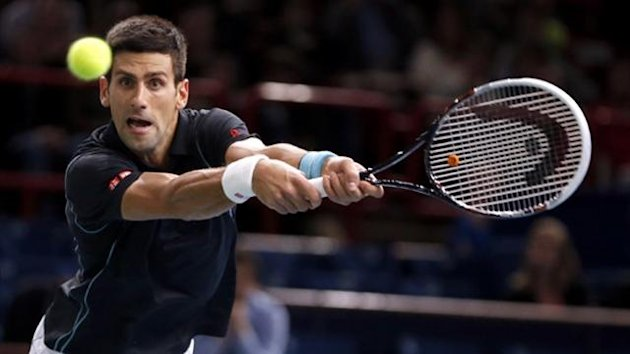Novak Djokovic of Serbia hits a returns to Pierre-Hugues Herbert of France at the Paris Masters (Reuters)