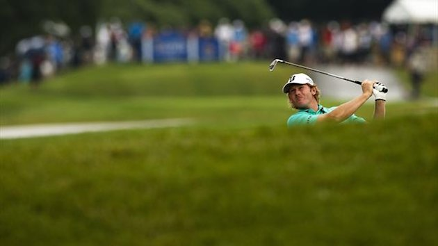 Brandt Snedeker hits from the bunker on the 17th hole during the third round at the Canadian Open (Reuters)