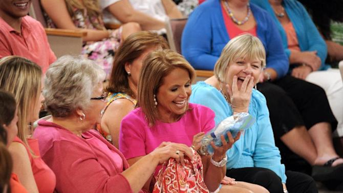 """This Aug. 8, 2012 photo released by Disney-ABC Domestic Television shows host Katie Couric sitting with audience members during a taping of her new talk show """"Katie."""" Couric's new show will debut on Monday, Sept. 10. (AP Photo/Disney-ABC Domestic TV, Ida Mae Astute)"""