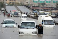 A Syrian man pushes his car after it stopped in a flooded avenue following heavy rain in the northern Syrian city of Aleppo. Syria&#39;s army and main rebel force said they will cease fire on Friday, in line with an internationally backed truce during a Muslim holiday, but both reserved the right to respond to any aggression