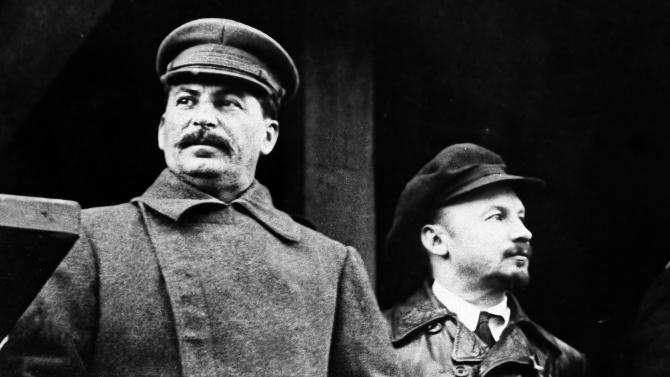 FILE - In this Nov. 21, 1930, file photo, from left to right, former Russian leader Josef Stalin and Soviet politician Nikolai Bukharin are seen together, in Moscow. North Korea's execution of Kim Jong-Un's uncle, on Thursday, Dec. 12, 2013, reminds many of the ways in which 20th century dictators such as Stalin, Adolf Hitler and Mao Zedong methodically ousted their opponents. Stalin and his cronies set up show trials of the late 1930s to convict and execute potential rivals — often with trumped-up charges and forced confessions. Bukharin was shot for spying. (AP Photo/File)