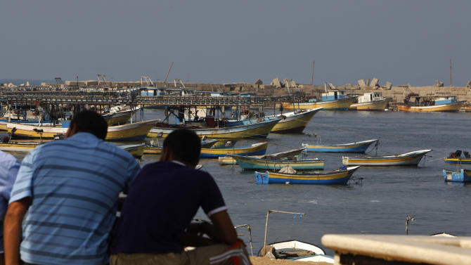 Palestinians sit by the port in Gaza City, Wednesday, Oct. 17, 2012. The Israeli military calculated the number of calories Gaza's residents would need to consume to avoid malnutrition during a sweeping blockade imposed on the Palestinian territory between 2007 and mid-2010, according to a document the Defense Ministry released reluctantly under a court order. (AP Photo/Adel Hana)