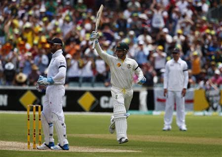Australia's captain Clarke celebrates his century as England's Prior and Pietersen look on during the second day of the second Ashes test cricket match in Adelaide