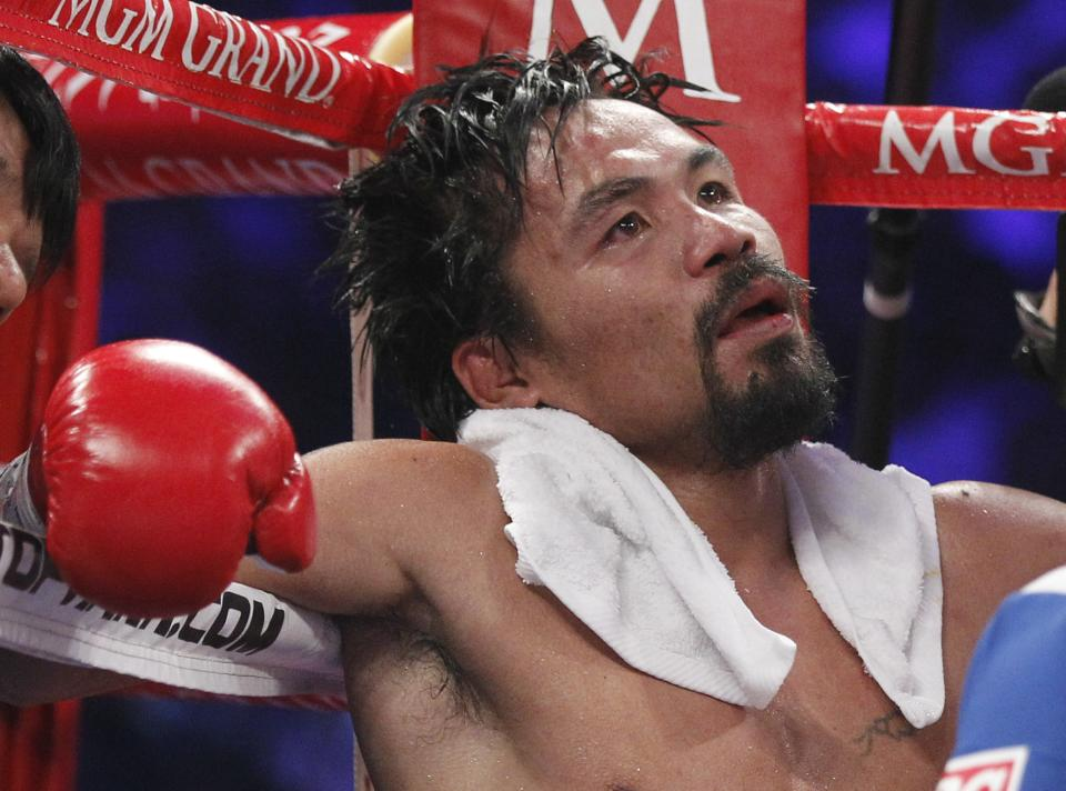 Manny Pacquiao, from the Philippines, sits in his corner following the eleventh round of his WBO welterweight title fight against Timothy Bradley, from Palm Springs, Calif., Saturday, June 9, 2012, in Las Vegas. Bradley won the bout by split decision. (AP Photo/Chris Carlson)