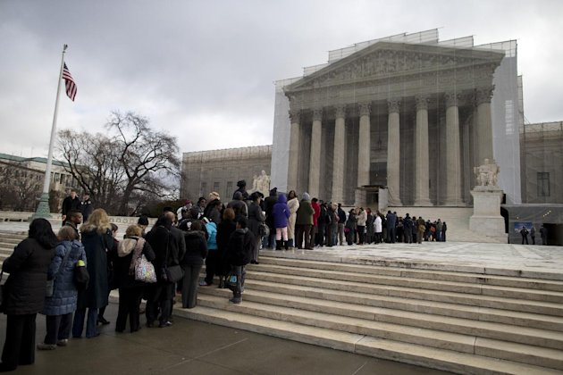 People wait in line outside the Supreme Court in Washington, Wednesday, Feb. 27,2013, to listen to oral arguments in the Shelby County, Ala., v. Holder voting rights case. The justices are hearing arguments in a challenge to the part of the Voting Rights Act that forces places with a history of discrimination, mainly in the Deep South, to get approval before they make any change in the way elections are held. (AP Photo/Evan Vucci)